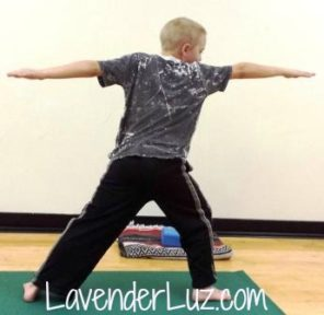 boy in warrior 2 yoga pose