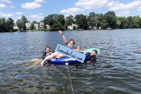 family on inner tube in lake